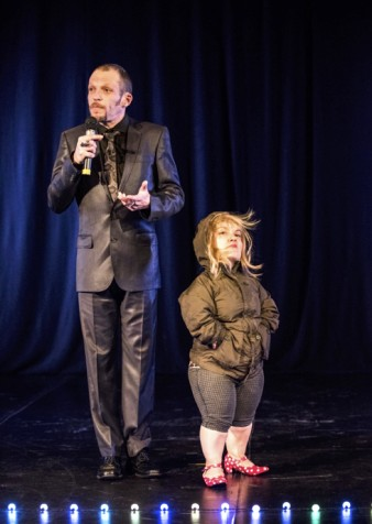 the tall gareth berliner and the short kiruna stammel are pictured in a 'stand-offish' pose on stage at the Why? Festival