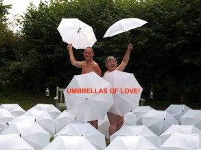 Photo of poets Vince Laws and Trudy Howson, pictured naked, surrounded by 100 white umbrellas, ready to be painted